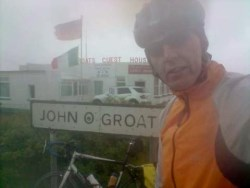 Kevin at John o'Groats preparing to cycle to Lands End
