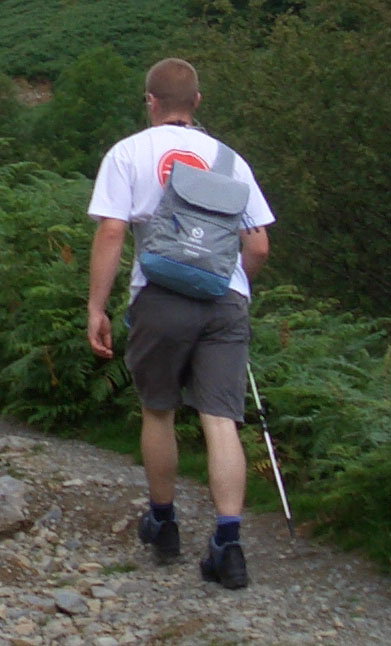 Walker equipped with walking pole, rucksack and sturdy boots